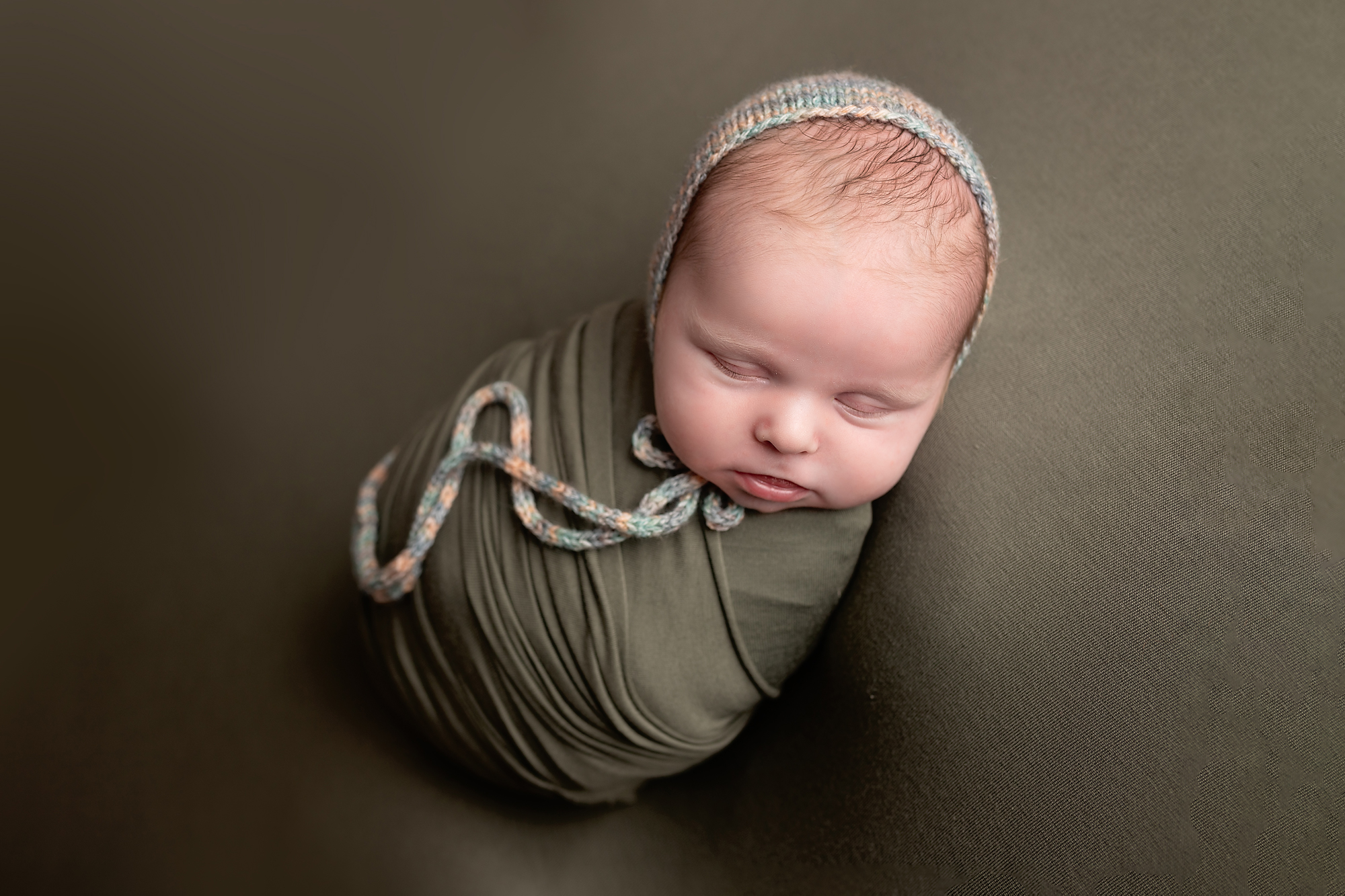 wrapped newborn baby by photography by edina