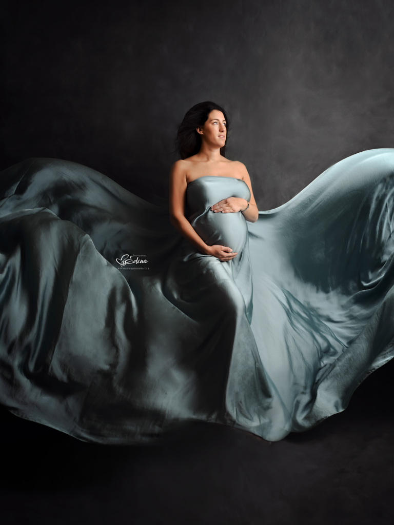 floating material maternity photo session