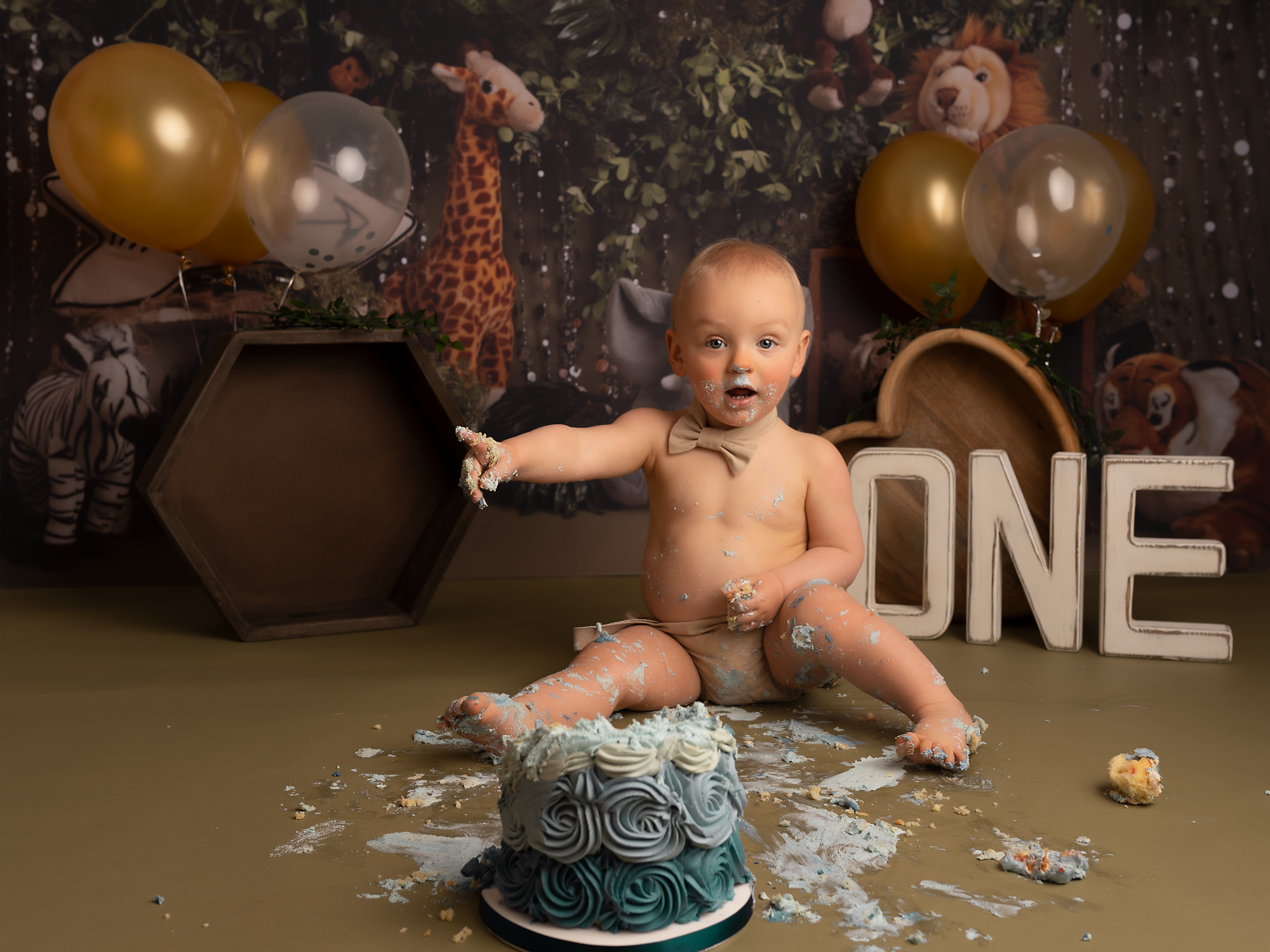 little boy during his first cake smash session