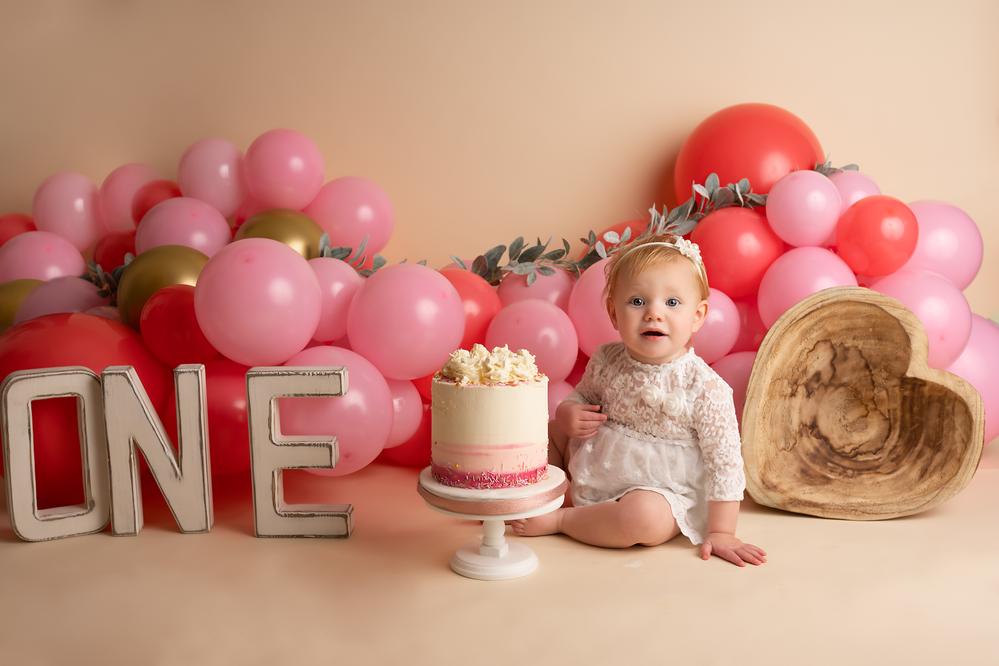 one year old girl during her cake smash session