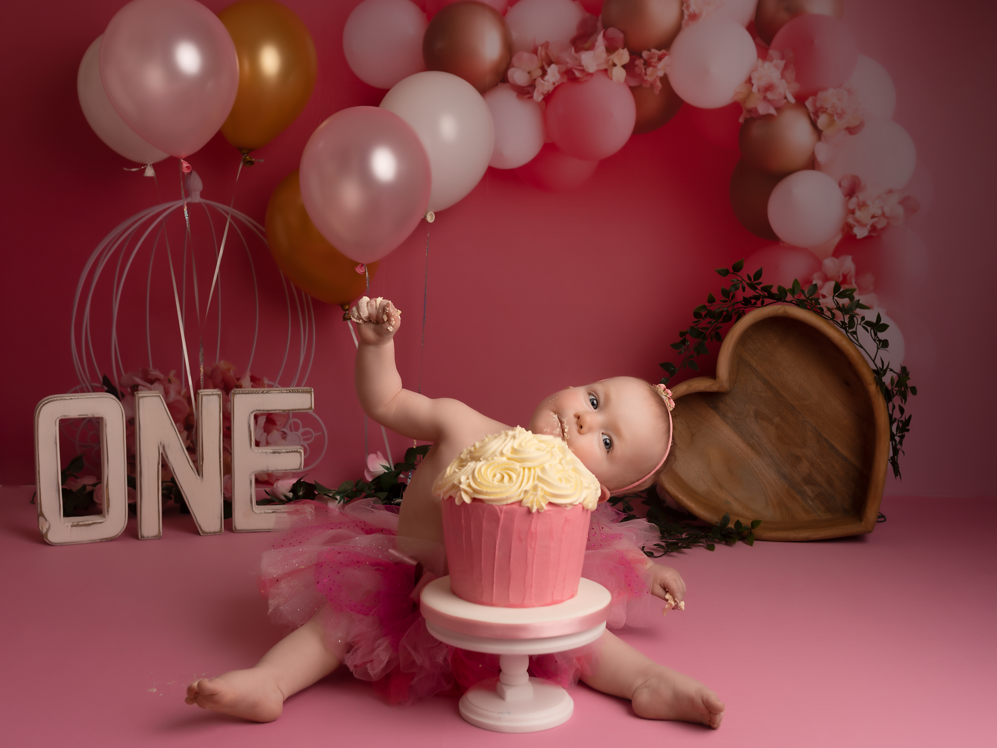 one year old girl playing with cake