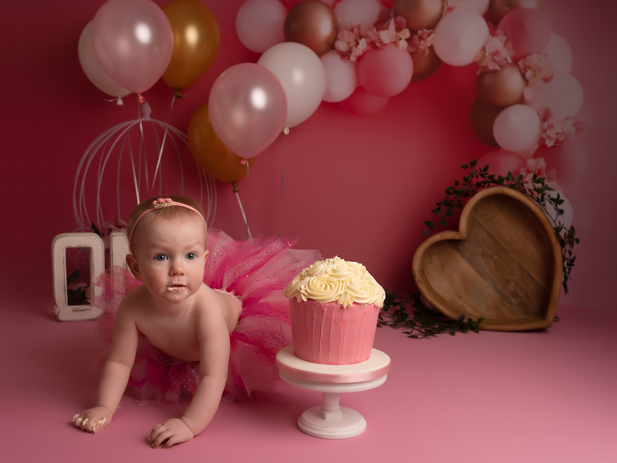 little girl on her first cake smash session
