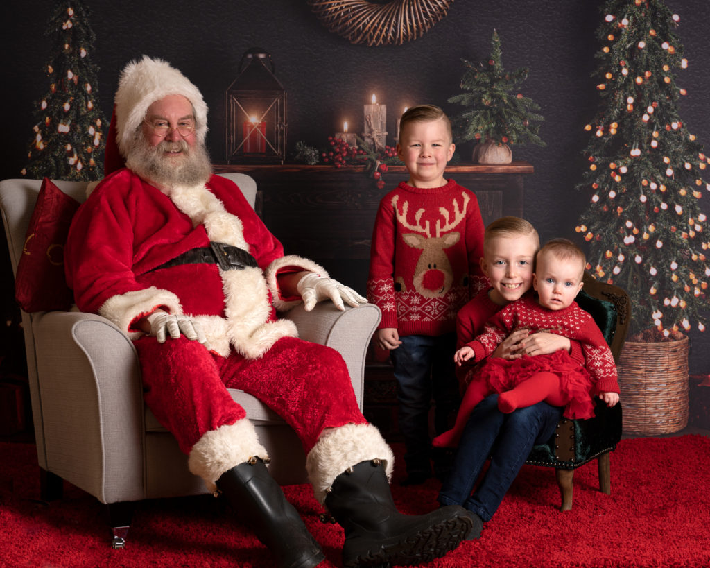 kids sitting with Santa on a photoshoot in York