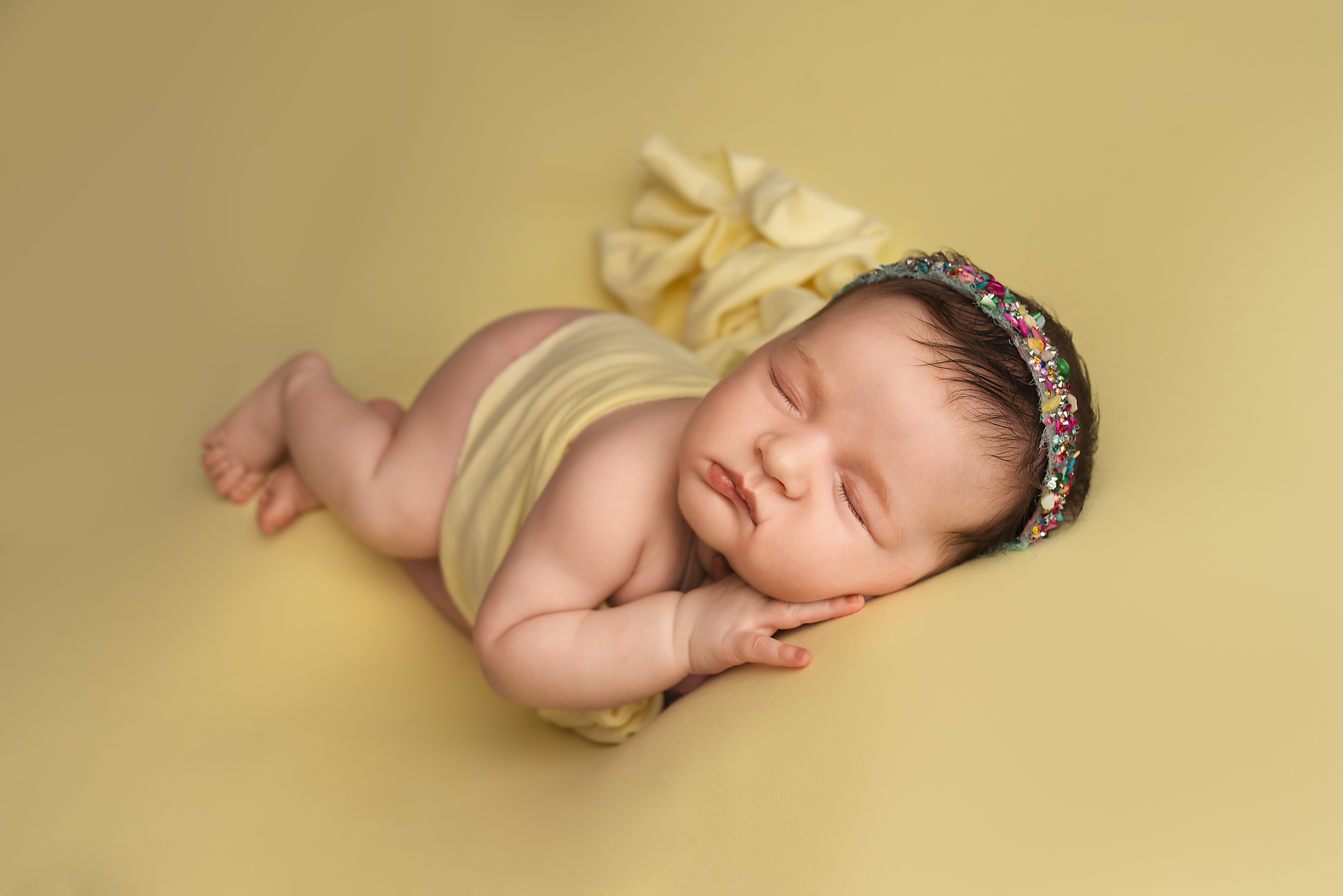 newborn baby being posed during a photo session in york